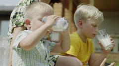 Children drinking milk Stock Footage