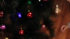 Two cute girls decorating Christmas tree. New year preparation. Girls having fun Stock Footage