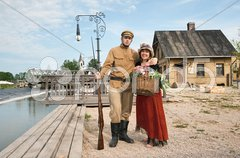 Couple of lady and soldier in retro style picture - stock photo