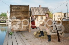 Lady and soldier with  gun in retro style picture Stock Photos