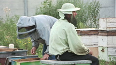 Tired beekeepers in the evening in the apiary Stock Footage