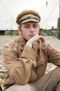 Retro style picture with resting soldier. Stock Photos