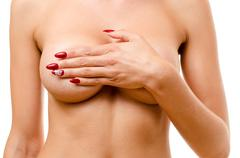 Nude woman covering her breasts Stock Photos
