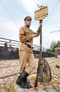 Retro style picture with soldier at tram stop. - stock photo