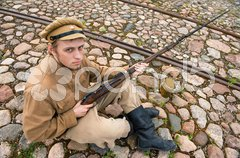 Soldier with boiler and gun in retro style picture Stock Photos