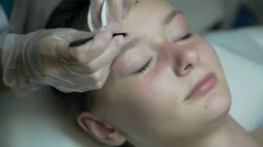 Correction of eyebrows in a beauty salon Stock Footage