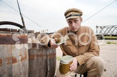 Soldier with boiler in retro style picture Stock Photos