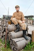 Retro style picture with soldier sitting on the bundles - stock photo