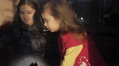 Girl decorates a window with the help of artificial snow. Preparing for the New Stock Footage