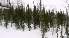 Ski track with chair lift, resort in mountains in slowmotion on cloudy day Stock Footage