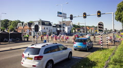 Crowd of people crossing a busy road with cars and traffic, 4K time lapse Stock Footage