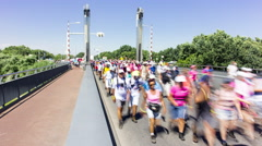 Crowd of people crossing a bridge during Vierdaagse Nijmegen, 4K time lapse Stock Footage