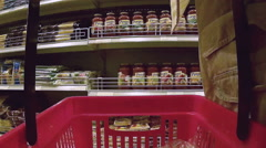 Supermarket POV: male shopper buys jar of pasta sauce Stock Footage