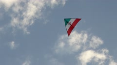 A kite with the design of flag of Iran flying in a cloudy sky Stock Footage
