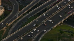 Aerial- cars moving in highway ramps in different directions, metropolitan day Stock Footage