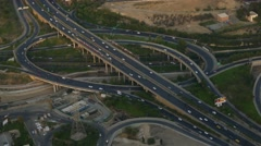 Aerial shot cars moving in highway ramps in different directions in a metropolis Stock Footage
