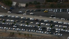 Aerial top view of huge number of cars parking on both side of a narrow street Stock Footage