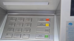 Hand Enters ATM PIN Code to Withdraw Money near Bank. Stock Footage
