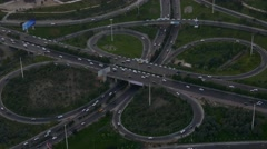 Aerial of cars moving in highway ramps in different directions traffic peak time Stock Footage