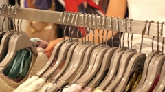 Woman in Clothing Store Choosing Clothes on Hangers Closeup Stock Footage