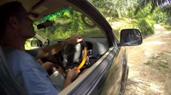 Off-road Jungle Travel on Car. Impassability of Road. Driver in Car. Stock Footage