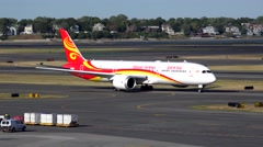 4K Hainan Airlines China Boeing 787 departs, runway Stock Footage