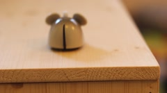A toy mice moving on a table comes and goes Stock Footage