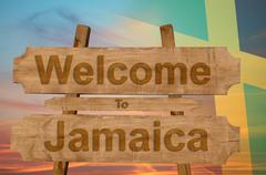 Welcome to Jamaica sign on wood background with blending national flag Kuvituskuvat