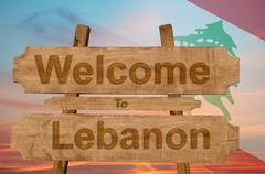 Welcome to Lebanon sign on wood background with blending national flag Kuvituskuvat