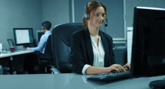 4K: A callcenter team is working in their office. Stock Footage