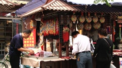 People choose traditional souvenirs at the shopping street in Xian, China. Stock Footage