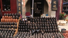 Person sells traditional souvenirs at the shopping street in Xian, China. Stock Footage