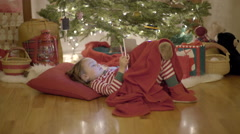 Little Boy Relaxes, Watches A Christmas Show On His Tablet, Eats A Candy Cane Stock Footage