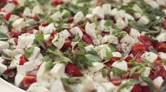 Close up view of fresh Italian salad, of tomatoes, cheese, salad. Stock Footage