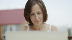 Woman using a laptop Stock Footage
