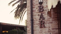 Slow motion, close up shooting of bar outdoors décor. Palm trees background. Stock Footage