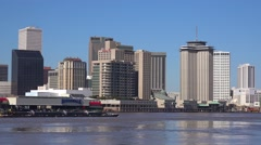 Establishing shot of the city of New Orleans with barges on the Mississippi Stock Footage