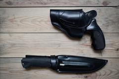 Gun and a knife Stock Photos