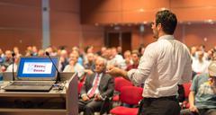 Public speaker giving talk at Business Event. Kuvituskuvat
