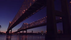 The Crescent City Bridge at night with New Orleans Louisiana in the background. Stock Footage