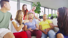 4K Happy group of friends socializing at home, chatting & laughing Stock Footage