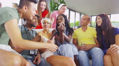 4K Happy group of friends socializing at home and having fun with technology Stock Footage