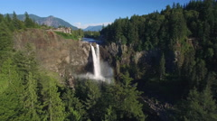Amazing Aerial of Rainbow in Snoqualmie Falls with Mount Si Background Stock Footage