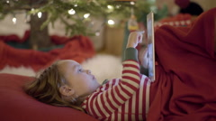 Closeup Of Little Boy, He Scrolls And Taps On His Tablet, Watches Video Stock Footage