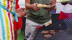 4K Happy young man cooking and serving barbecue food to his friends Stock Footage