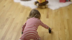 Happy Child Plays With Toy Train In Front Of Christmas Tree Stock Footage
