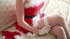 Sexy Santa Girl caresses herself. sex games. straightens stockings Stock Footage