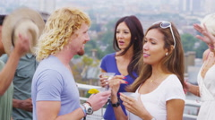 4K Attractive group of friends partying on a rooftop terrace with view Stock Footage
