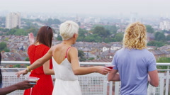 4K Excited friends at penthouse apartment party run out to look at view Stock Footage