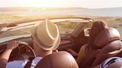 Cute Young Couple Driving At Sea Front Woman Enjoying Waiving Arms In The Air In Stock Footage